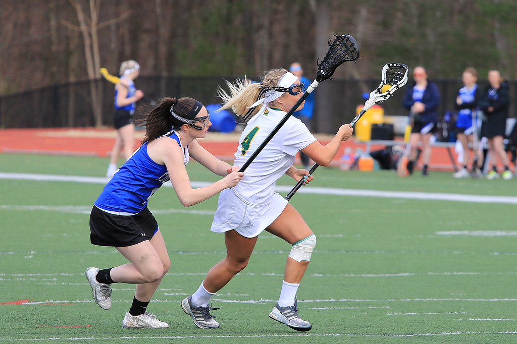 . Fitchburg State University women\'s lacrosse played Colby-Sawyer College on Tuesday afternoon at FSU\'s Elliot Field in Fitchburg. FSU\'s Sarah Napolitano tries to hold onto the ball while being covered by CSC\'s Caroline Tompkins. Fitchburg State lost, 11-10. SENTINEL & ENTERPRISE/JOHN LOVE