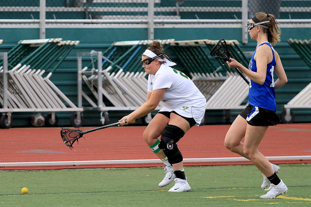 . Fitchburg State University women\'s lacrosse played Colby Sawyer on Tuesday afternoon at FSU\'s Elliot Field in Fitchburg. FSU\'s Tracy Long chases down the ball followed by CSC\'s Jaime Wood during action in the game. SENTINEL & ENTERPRISE/JOHN LOVE