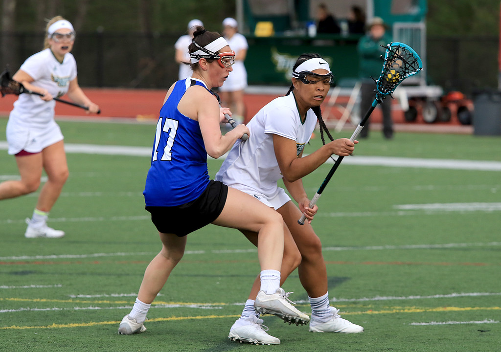 . Fitchburg State University women\'s lacrosse played Colby Sawyer on Tuesday afternoon at FSU\'s Elliot Field in Fitchburg. FSU\'s Amanda Hem tries to hold onto the ball as she is covered by CSC\'s Allison Piracini. SENTINEL & ENTERPRISE/JOHN LOVE