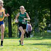Fitchburg State University Cross Country teams held the Jim Sheehan Memorial Invitational at the Doyle Conservation Area in Leominster on Saturday, September 7, 2019.  FSU's Olivia Mullins (#55), on right, runs next to Western NE's Brooke Townsend. SENTINEL & ENTERPRISE/JOHN LOVE