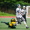 Fitchburg State University's Damar Collins brings down a Castleton ball runner on Saturday afternoon. SENTINEL & ENTERPRISE / Ashley Green