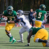 Fitchburg State University football played Westfield State University Saturday, Oct. 26, 2019 at Elliot Field. FSU's #2 Melchior Lynch tries to find some running room as he is grabbed by WSU's #46 David White. SENTINEL & ENTERPRISE/JOHN LOVE