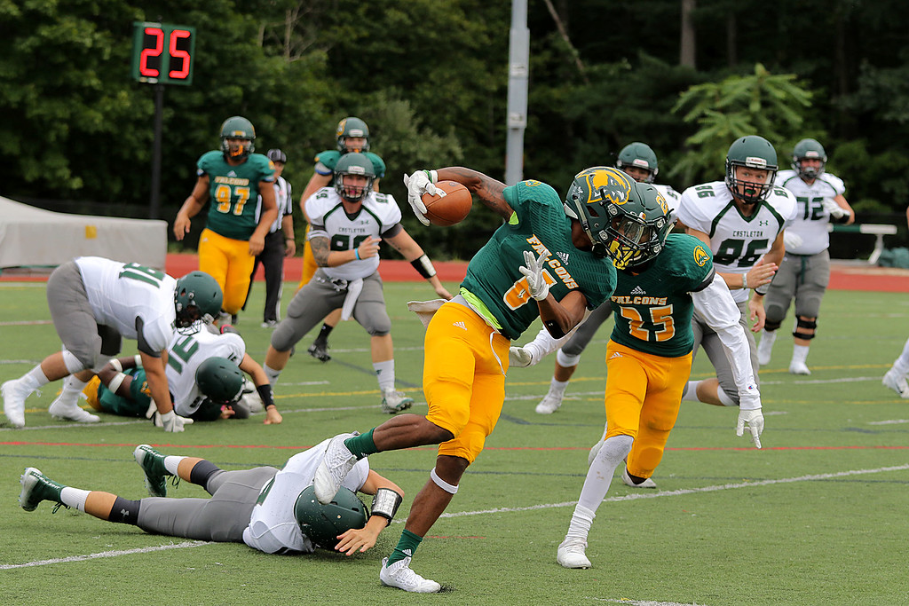 . Fitchburg State University Falcons took on Castleton Spartans on Saturday afternoon in Fitchburg. FSU\'s Mike Craeford avoids a tackle by CU player Bart Yarosz during action in the game. SENTINEL & ENTERPRISE/JOHN LOVE