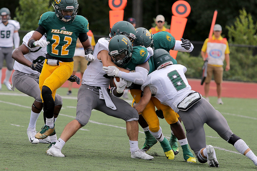 . Fitchburg State University Falcons took on Castleton Spartans on Saturday afternoon in Fitchburg. FSU \'s Christopher Tamukedde is taken down as he carries the ball during action in the game. SENTINEL & ENTERPRISE/JOHN LOVE