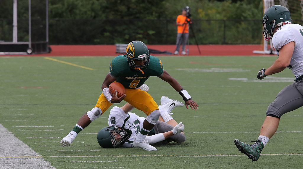 . Fitchburg State University Falcons took on Castleton Spartans on Saturday afternoon in Fitchburg. Brandon Brown avoids a tackle by CU\'s Ethan Sherwood during action in the game. SENTINEL & ENTERPRISE/JOHN LOVE