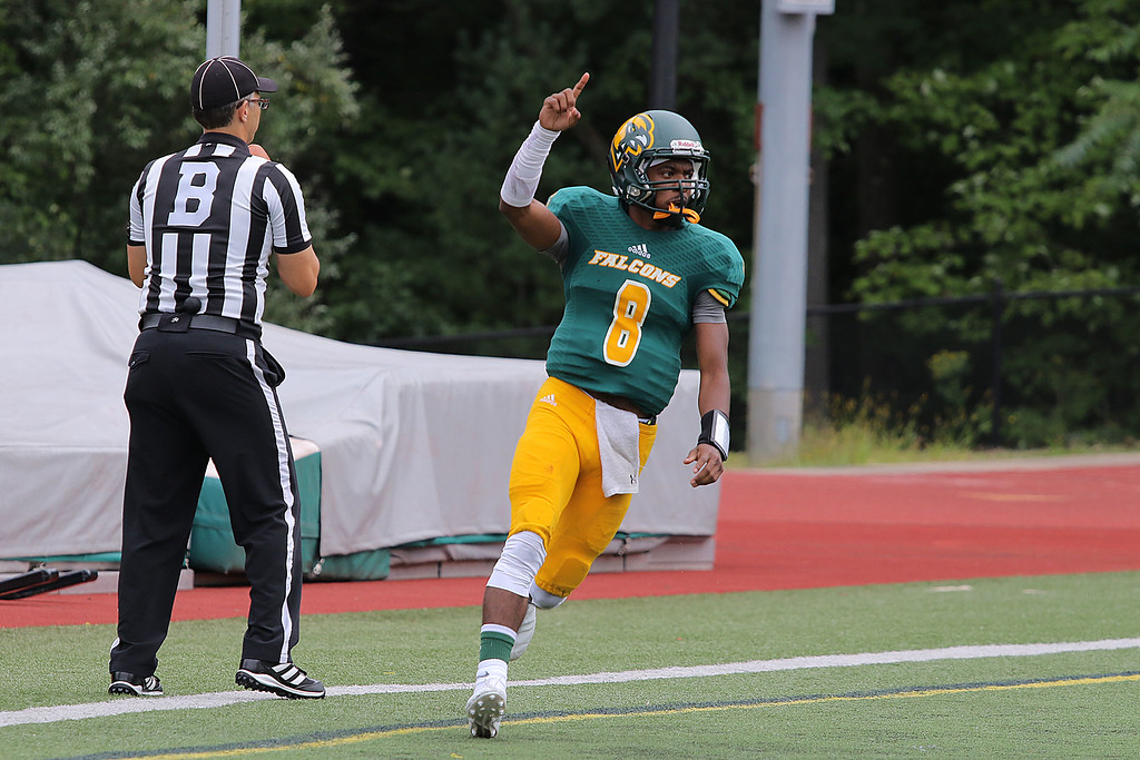 . Fitchburg State University Falcons took on Castleton Spartans on Saturday afternoon in Fitchburg. FSU\'s Brandon Brown celebrates after scoring atouchdown. SENTINEL & ENTERPRISE/JOHN LOVE