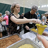 "The incoming freshmen class at Fitchburg State University helped package up tjhe stuff to make minestrone soup in the gym at the university's Recreation Center on Tuesday morning. This project is sponsored by the United Way of North Central MA. and the University and is part of the students orientation. All of the ingredients for the soups is brought by ""The Outreach Program."" The ingredients for the soup is pasta, pinto beans, soy beans, dehydrated vegetables and red sauce. Freshman Emma Jacques helps fill bags with the ingredients during the event. SENTINEL & ENTERPRISE/JOHN LOVE"