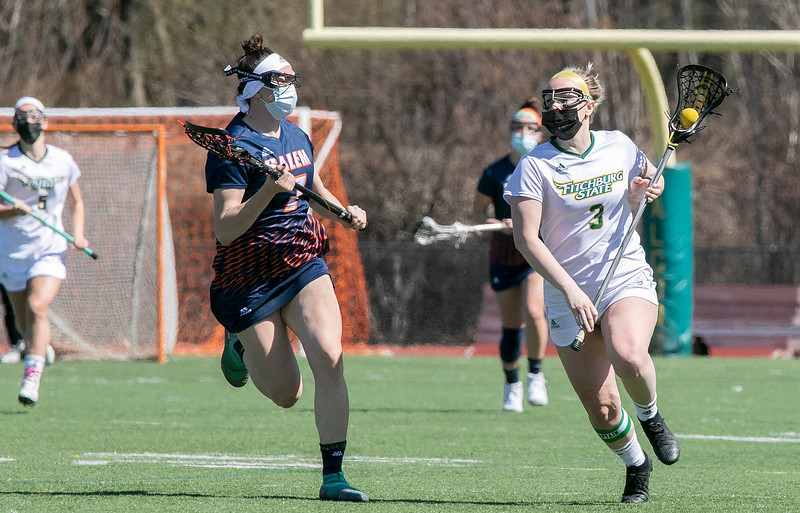 Fitchburg State University ladies lacrosse played Salem State University on Saturday, March 27, 2021 at Elliot Field.  SSU's #7 Madison White follows FSU's #3 Nicole Kopacz as she takes off down field. SENTINEL & ENTERPRISE/JOHN LOVE