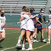 Fitchburg State University ladies lacrosse played Salem State University on Saturday, March 27, 2021 at Elliot Field. FSU's #14 Julia Miele gets hugged by her teammate #10 Madison Alves after she scored.  SENTINEL & ENTERPRISE/JOHN LOVE