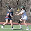 Fitchburg State University ladies lacrosse played Salem State University on Saturday, March 27, 2021 at Elliot Field.  FSU's #13 Samira El-Hakim plays some defense against SSU's Tara McLaughlin. SENTINEL & ENTERPRISE/JOHN LOVE
