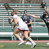 Fitchburg State University ladies lacrosse played Salem State University on Saturday, March 27, 2021 at Elliot Field. SSU's #10 Mackenzie Schmink tries to stop FSU's #14 Julia Miele. SENTINEL & ENTERPRISE/JOHN LOVE