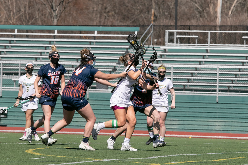 Fitchburg State University ladies lacrosse played Salem State University on Saturday, March 27, 2021 at Elliot Field.  FSU's #14 Julia Miele tries to make it by two SSU players. SENTINEL & ENTERPRISE/JOHN LOVE