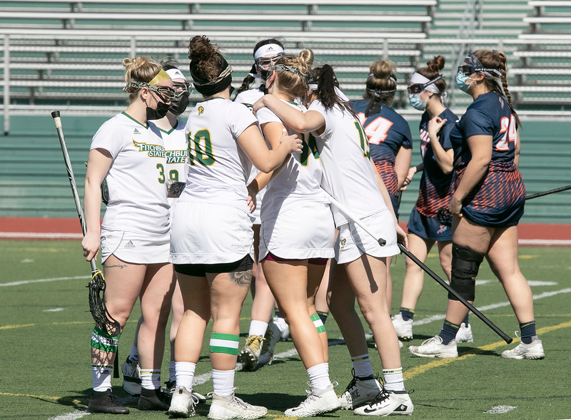 Fitchburg State University ladies lacrosse played Salem State University on Saturday, March 27, 2021 at Elliot Field.  FSU's Julia Miele is congratulated by her team after a score. SENTINEL & ENTERPRISE/JOHN LOVE