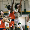 Fitchburg State University men's basketball played Salem State University on Saturday, Jan. 11, 2020 at the FSU's Recreation Center. FSU's #22 Dominik Williams tries to get as hot by SSU's #24 Hakeem Animashaun. SENTINEL & ENTERPRISE/JOHN LOVE