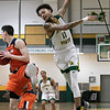 Fitchburg State University men's basketball played Salem State University on Saturday, Jan. 11, 2020 at the FSU's Recreation Center. FSU's #11 Jordan Jones just misses getting a rebound. SENTINEL & ENTERPRISE/JOHN LOVE