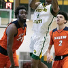 Fitchburg State University men's basketball played Salem State University on Saturday, Jan. 11, 2020 at the FSU's Recreation Center. FSU's #4 Devon Johnson drives to the basket by SSU's #24 Hakeem Animashaun and #2 Chris MacDonald. SENTINEL & ENTERPRISE/JOHN LOVE