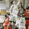 Fitchburg State University men's basketball played Salem State University on Saturday, Jan. 11, 2020 at the FSU's Recreation Center. FSU's #33 Keegan Sharp reaches for a rebound as his teammate #4 Devon Johnson looks on. SENTINEL & ENTERPRISE/JOHN LOVE