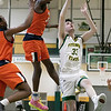 Fitchburg State University men's basketball played Salem State University on Saturday, Jan. 11, 2020 at the FSU's Recreation Center. FSU's #33 Keegan Sharp drives to the basket by SSU's #24 Hakeem Animashaun and #1 Alex De La Rosa. Animashaun blocks Sharps shot. SENTINEL & ENTERPRISE/JOHN LOVE