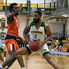 Fitchburg State University men's basketball played Salem State University on Saturday, Jan. 11, 2020 at the FSU's Recreation Center. FSU's #1Charles Doss is covered  by SSU's #24 Hakeem Animashaun as he drives to the basket. SENTINEL & ENTERPRISE/JOHN LOVE