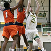 Fitchburg State University men's basketball played Salem State University on Saturday, Jan. 11, 2020 at the FSU's Recreation Center. FSU's #33 Keegan Sharp drives to the basket by SSU's #24 Hakeem Animashaun and #1 Alex De La Rosa. SENTINEL & ENTERPRISE/JOHN LOVE