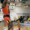 Fitchburg State University men's basketball played Salem State University on Saturday, Jan. 11, 2020 at the FSU's Recreation Center. FSU's #3 Xavier Betancourt is covered  by SSU's #24 Hakeem Animashaun as he drives to the basket. SENTINEL & ENTERPRISE/JOHN LOVE