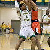 Fitchburg State University men's basketball played Salem State University on Tuesdsay night, January 9, 2019 at FSU's Recreation Center. FSU's Jonathan Perez is covered by SSU's Chris MacDonald during  action in the game. SENTINEL & ENTERPRISE/JOHN LOVE