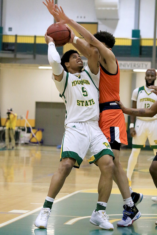 . Fitchburg State University men\'s basketball played Salem State University on Tuesdsay night, January 9, 2019 at FSU\'s Recreation Center. FSU\'s Jonathan Perez is covered by SSU\'s Chris MacDonald during  action in the game. SENTINEL & ENTERPRISE/JOHN LOVE