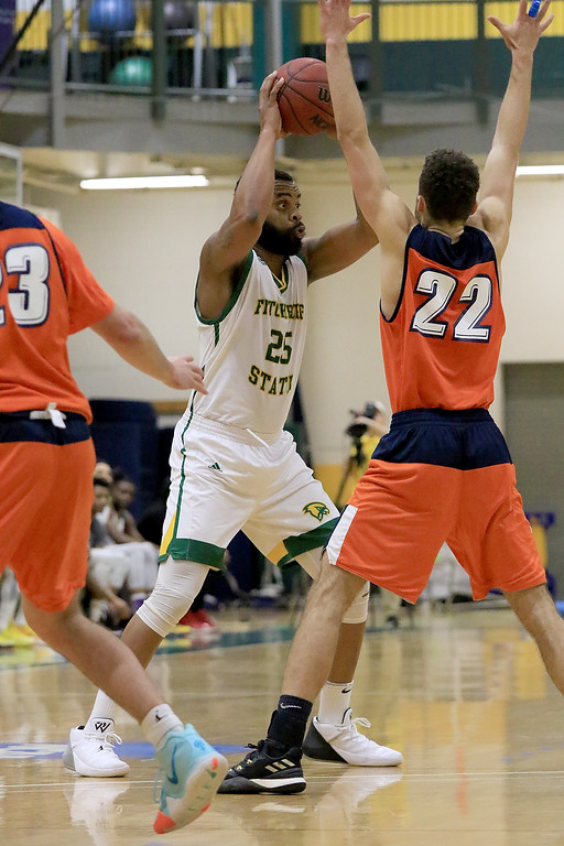 . Fitchburg State University men\'s basketball played Salem State University on Tuesdsay night, January 9, 2019 at FSU\'s Recreation Center. FSU\'s Charles Doss loosk for a teammate to pass to while being covered by Bryan Martinez during action in the first half of the game. SENTINEL & ENTERPRISE/JOHN LOVE
