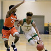 Fitchburg State University men's basketball played Salem State University on Tuesdsay night, January 9, 2019 at FSU's Recreation Center. FSU's Andre Ruff drives past SSU's Melvin Worley. SENTINEL & ENTERPRISE/JOHN LOVE