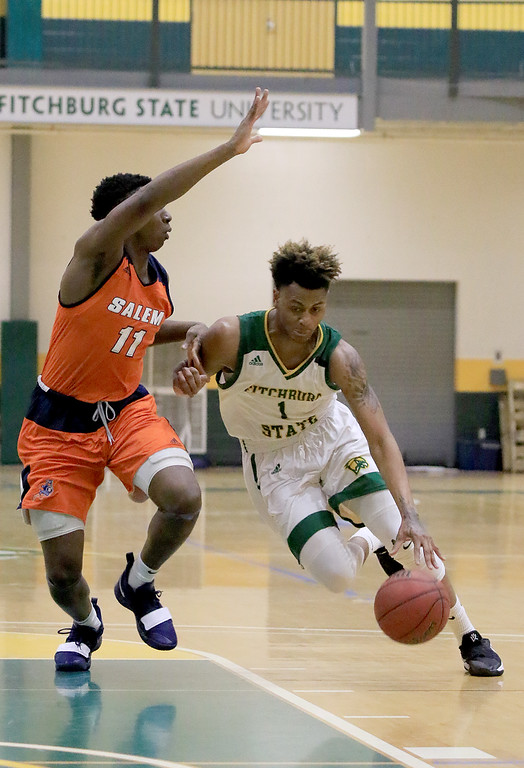 . Fitchburg State University men\'s basketball played Salem State University on Tuesdsay night, January 9, 2019 at FSU\'s Recreation Center. FSU\'s Andre Ruff drives past SSU\'s Melvin Worley. SENTINEL & ENTERPRISE/JOHN LOVE