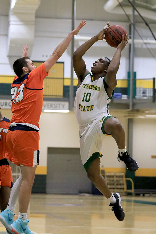 . Fitchburg State University men\'s basketball played Salem State University on Tuesdsay night, January 9, 2019 at FSU\'s Recreation Center. FSU\'s Tyrell St. John takes a shot over SSU\'s Sean Bryan during action in the first half of the game. SENTINEL & ENTERPRISE/JOHN LOVE