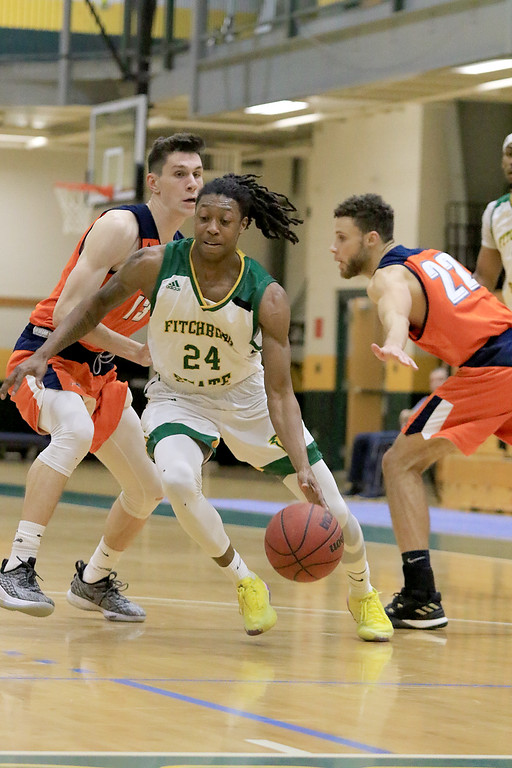 . Fitchburg State University men\'s basketball played Salem State University on Tuesdsay night, January 9, 2019 at FSU\'s Recreation Center. FSU\'s Nicholas Tracy drives to the basket right by SSU\'s Evan Mason and Bryan Martinez. SENTINEL & ENTERPRISE/JOHN LOVE