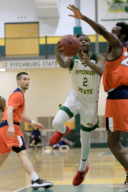 . Fitchburg State University men\'s basketball played Salem State University on Tuesdsay night, January 9, 2019 at FSU\'s Recreation Center. FSU\'s Joshua Nelson goes in for a shot on the basket. SENTINEL & ENTERPRISE/JOHN LOVE