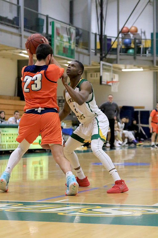 . Fitchburg State University men\'s basketball played Salem State University on Tuesdsay night, January 9, 2019 at FSU\'s Recreation Center. FSU\'s Joshua Nelson puts some full court press on SSU\'s Sean Bryan in the first half of the game. SENTINEL & ENTERPRISE/JOHN LOVE