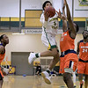Fitchburg State University men's basketball played Salem State University on Tuesdsay night, January 9, 2019 at FSU's Recreation Center. FSU's Jonathan Perez takes a shot over SSU's Tyler McNeil during action in the game. SENTINEL & ENTERPRISE/JOHN LOVE