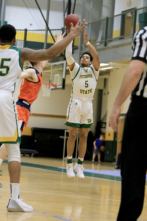 . Fitchburg State University men\'s basketball played Salem State University on Tuesdsay night, January 9, 2019 at FSU\'s Recreation Center. FSU\'s Jonathan Perez puts up a three point shot during action in the first half of the game.  SENTINEL & ENTERPRISE/JOHN LOVE