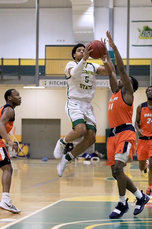 . Fitchburg State University men\'s basketball played Salem State University on Tuesdsay night, January 9, 2019 at FSU\'s Recreation Center. FSU\'s Jonathan Perez takes a shot over SSU\'s Tyler McNeil during action in the game. SENTINEL & ENTERPRISE/JOHN LOVE