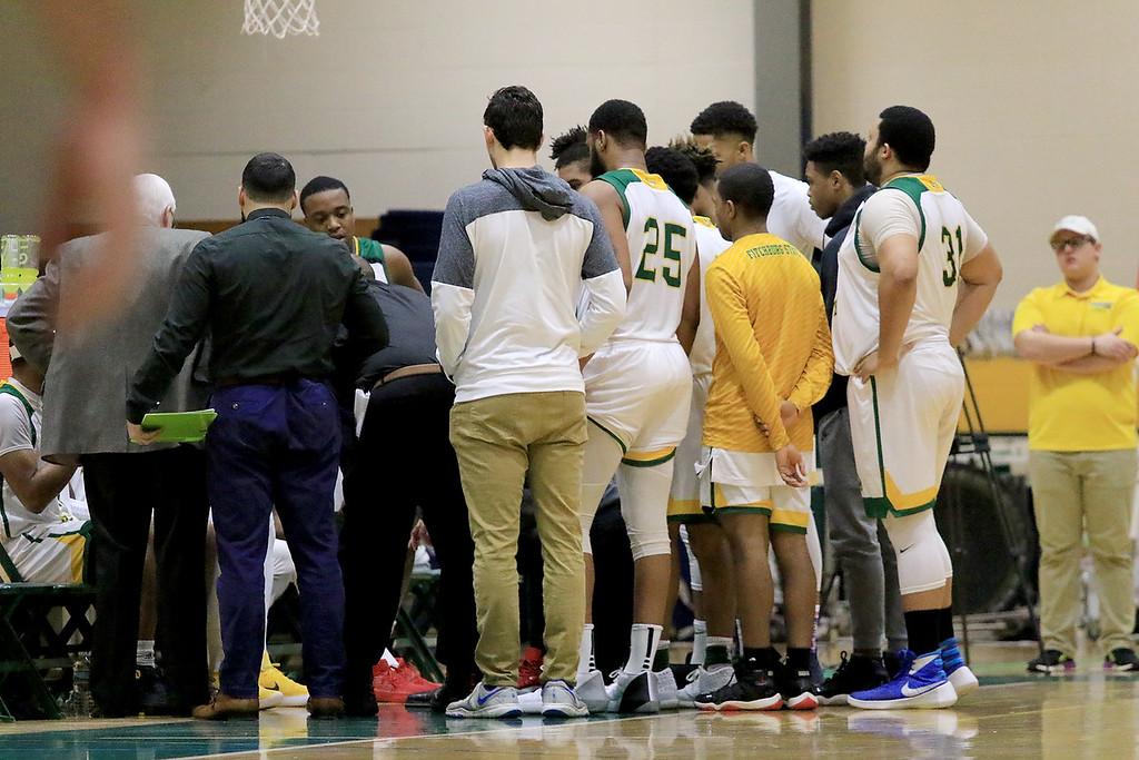 . Fitchburg State University men\'s basketball played Salem State University on Tuesdsay night, January 9, 2019 at FSU\'s Recreation Center. FSU during a timeout. SENTINEL & ENTERPRISE/JOHN LOVE
