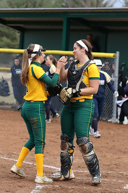 . Fitchburg State University softball played Massachusetts Maritime in a double header on Friday afternoon in Fitchburg. FSU catcher Melissa DiPhilippo get congratulated for make a nice catch behind the plate after a pop up by pitcher Emma Campbell during action in the second game of the double header. SENTINEL & ENTERPRISE/JOHN LOVE