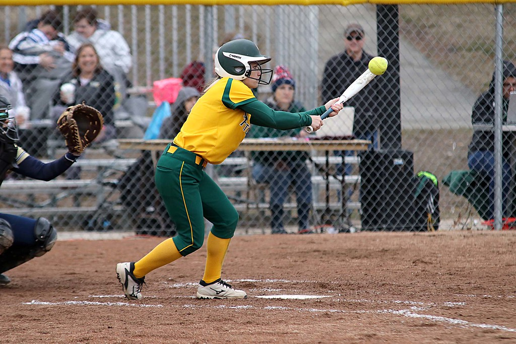 . Fitchburg State University softball played Massachusetts Maritime in a double header on Friday afternoon in Fitchburg. FSU player Samantha Woodman tries a bunt during action in the second game of the double header. SENTINEL & ENTERPRISE/JOHN LOVE