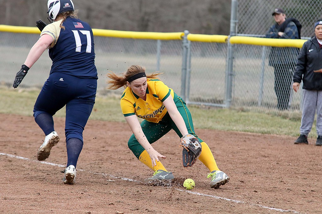 . Fitchburg State University softball played Massachusetts Maritime in a double header on Friday afternoon in Fitchburg. FSU first baseman Kaitlin Carman stops the ball before it became fair as MA Maritime player Rachel Gardner runs down the first base line during the first game of the double header. SENTINEL & ENTERPRISE/JOHN LOVE