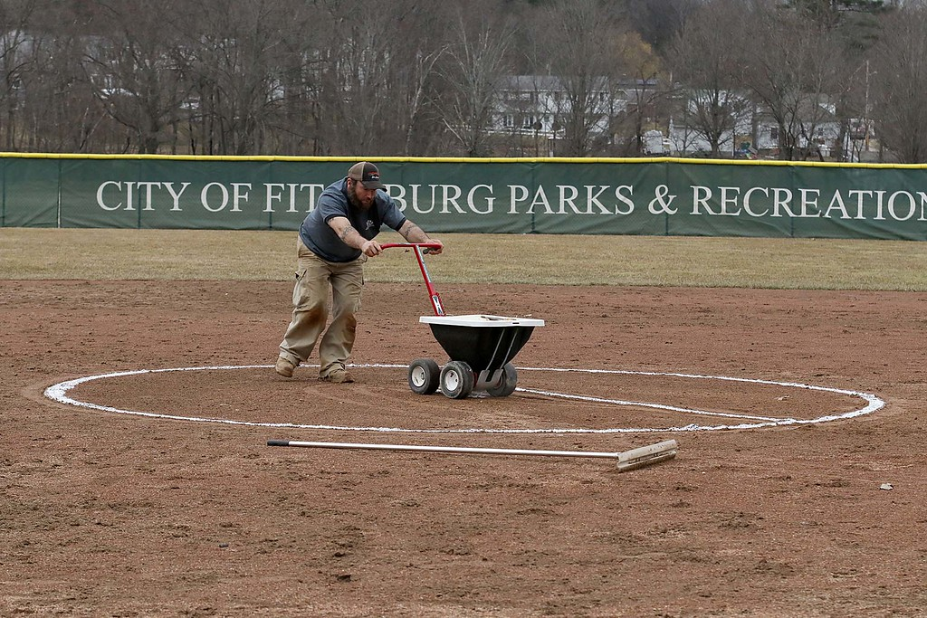 . Fitchburg State University softball played Massachusetts Maritime in a double header on Friday afternoon in Fitchburg. Getting the field ready for the second game of the double header is Derek Lafratta with the North Turf company. SENTINEL & ENTERPRISE/JOHN LOVE