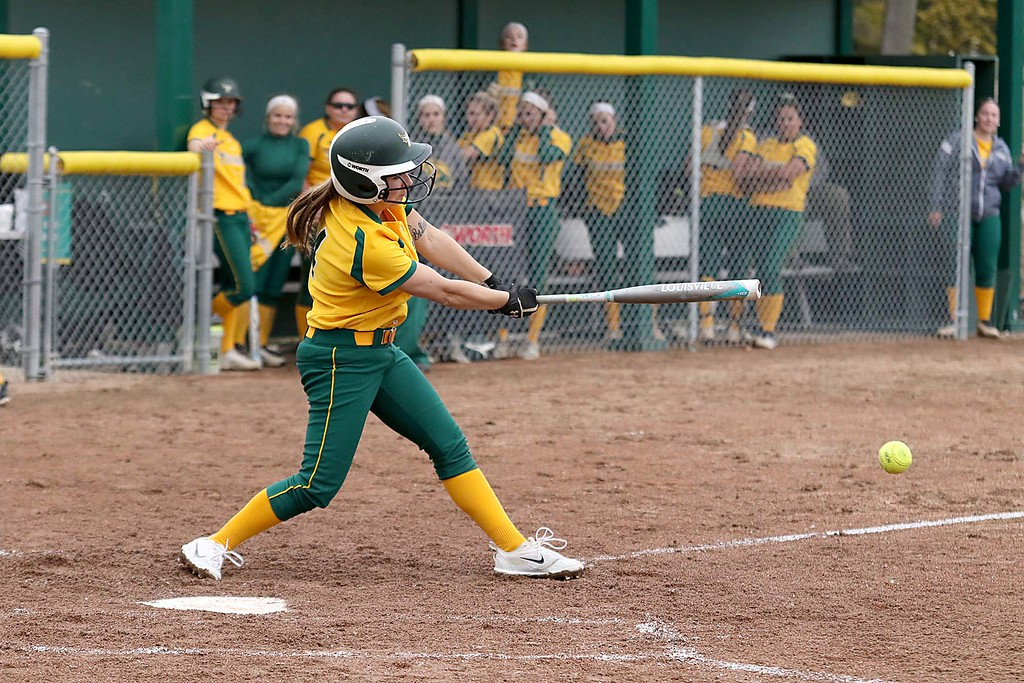 . Fitchburg State University softball played Massachusetts Maritime in a double header on Friday afternoon in Fitchburg. FSU player Keeliey Zompetti make contact with the ball while at bat during the first game of the double header. SENTINEL & ENTERPRISE/JOHN LOVE