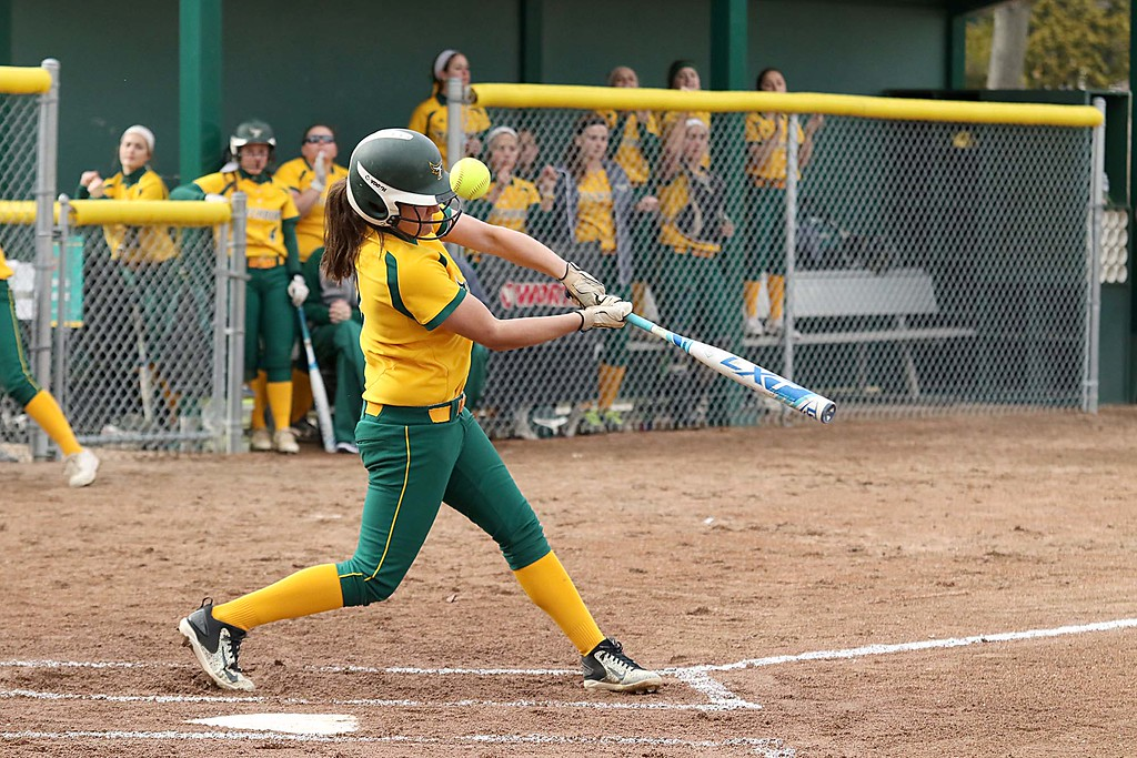 . Fitchburg State University softball played Massachusetts Maritime in a double header on Friday afternoon in Fitchburg. FSU player Maddie Medina tips the ball foul during action in the second game of the double header. SENTINEL & ENTERPRISE/JOHN LOVE