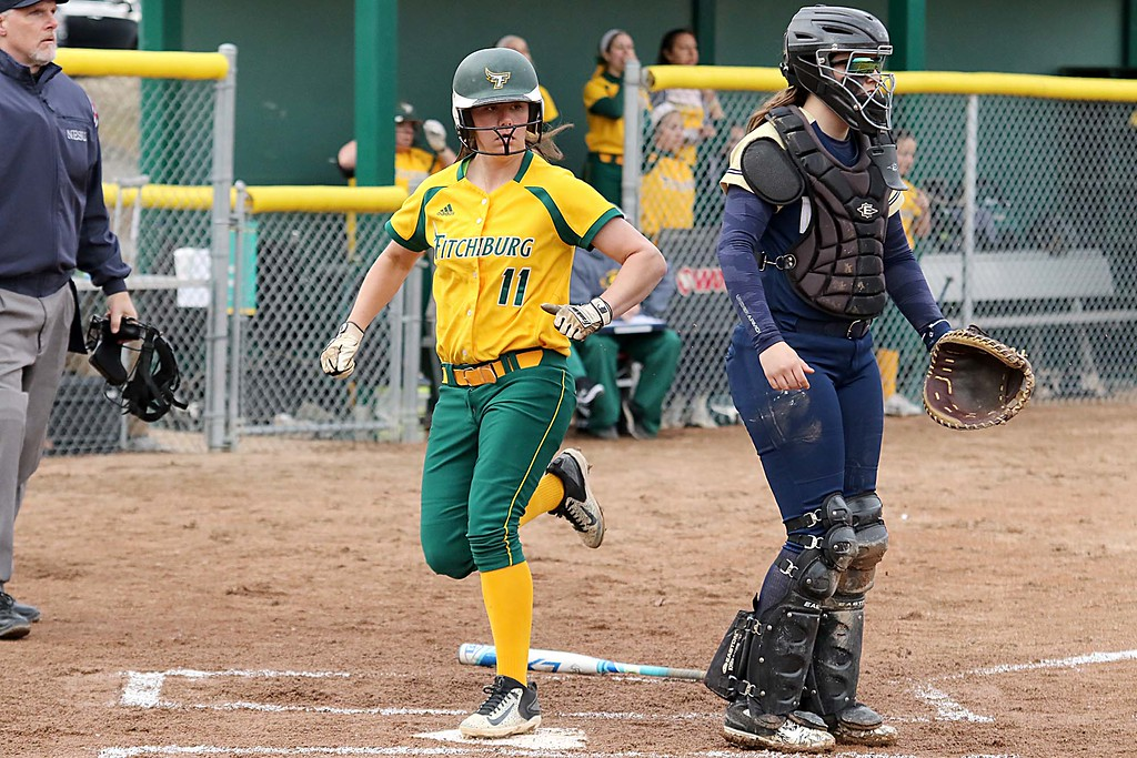 . Fitchburg State University softball played Massachusetts Maritime in a double header on Friday afternoon in Fitchburg. FSU player Maddie Medina crosses home plate for a score during action in the second game of the double header. SENTINEL & ENTERPRISE/JOHN LOVE