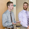 Eighteen Fitchurg State University students who have been working with faculty on paid research programs involving the health of the Fitchburg Community presented their work Thursday, July 27, 2017 at the Mazzaferro Center in Presidents' Hall at the University. Jacob Hogue, 22, from Lunenburg listens to his partner Sean Beverly, 21, from Lunenburg as he talks about their findings on the terrain of the Nashua River in Fitchburg. SENTINEL & ENTRPRISE/JOHN LOVE
