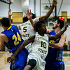 Fitchburg State's #5 Jalen Williams and #10 Mustapha Koroma go for the rebound during the game against Worcester State on Thursday, February 23, 2017. WSU would come out on top 71-68, moving on to the MASCAS finals on Saturday. SENTINEL & ENTERPRISE / Ashley Green