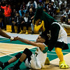 Fitchburg State's Leonny Burgos gets a hand from the Falcon during the game against Worcester State on Thursday, February 23, 2017. WSU would come out on top 71-68, moving on to the MASCAS finals on Saturday. SENTINEL & ENTERPRISE / Ashley Green