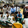 Fitchburg State huddles up with head coach Titus Manderson during the game against Worcester State on Thursday, February 23, 2017. WSU would come out on top 71-68, moving on to the MASCAS finals on Saturday. SENTINEL & ENTERPRISE / Ashley Green