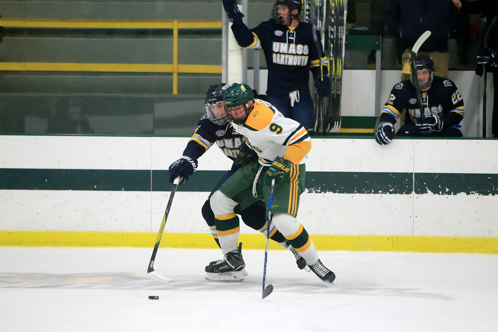 . FSU Kyle Hillick fights for the puck FSU vs UMass Dartmouth SENTINEL&ENTERPRISE/Scott LaPrade
